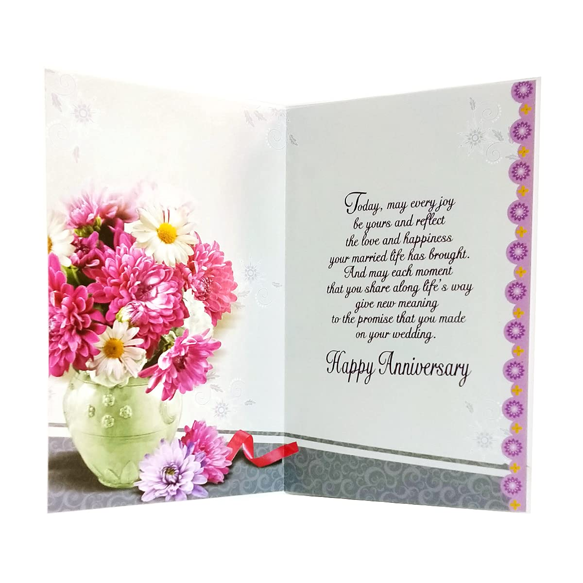 Happy anniversary book and flowers